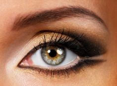 Gray, black, tan, and a little bit of light gold makes for a perfect light smoky eye look.