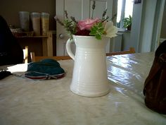 Country posy in a milk jug
