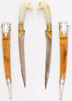 Indian jambiya dagger, 18th century, teel, silver, gold, ruby, velvet, bofwood,  H. with sheath 13 3/8 in. (34 cm); H. without sheath 12 5/16 in. (31.3 cm); H. of blade 8 in. (20.3 cm); W. 2 1/16 in. (5.2 cm); Wt. 5.1 oz. (144.6 g); Wt. of sheath 1.9 oz. (53.9 g), Met Museum, Bequest of George C. Stone, 1935. Swords And Daggers, Knives And Swords, Dagger Knife, Sword And Sorcery, Arm Armor, Cold Steel, Fantasy Rpg, Museum Collection, Metropolitan Museum