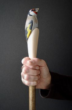 Goldfinch walking stick carved by hand in lime timber with a coppice hazel shank. Painted with artist acrylics.
