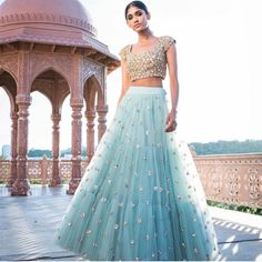 The Stylish And Elegant Lehenga Choli In Sky Blue Colour Looks Stunning And Gorgeous With Trendy And Fashionable Embroidery .The Net Fabric Party Wear Lehenga Choli Looks Extremely Attractive And Ca. Indian Fashion Dresses, Indian Gowns Dresses, Dress Indian Style, Indian Designer Outfits, Designer Dresses, Net Lehenga, Indian Lehenga, Lehenga Choli, Anarkali