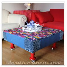 coffee table ottoman - inspired! (made from an old couch cushion and 4 IKEA candle holders!!)