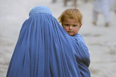 Daily life in Kabul    An Afghan woman carried her child in the old section of Kabul.