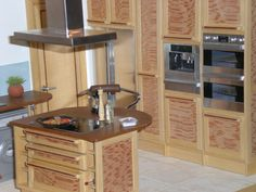ELF Modern Miniature interiors---https://flic.kr/p/4mrDjY | detail miniature kitchen | 1/12th scale in a light wood with panels in silky Australian oak.  This is part of the kitchen, the other side has the sink, a corner carousel, and horizontal wall units.