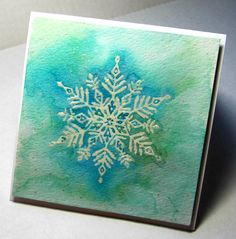 November 2016.  Watercolor snowflake using emboss resist technique. So elegant!  You may want to frame this one!  Icy blue and green design was inspired by an original watercolor painting by Susan Windsor.  http://www.susanwindsor.com/  She was inspired by Wilson Bentley, the first photographer to capture a single snowflake using a microscope and his camera in 1885. Truly amazing!  See my inspiration from both Susan and Wilson on my CASE'd board.