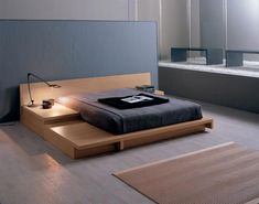 Hiro Bed by Silenia. Love the low height, asymmetrical shape and the built-in nightstand.