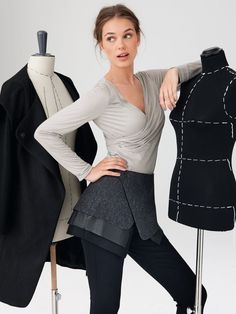 """Labeled a """"hip wrap"""" this layered skirt with snap closure is designed to be worn over leggings or skinny pants."""