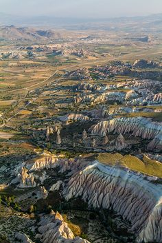Aerial view over Cappadocia, nearby Gorëme, Turkey. Features from top to bottom, the city of Çavusin and the rose and red valleys (güllüdere and kizilçukur valleys) Aerial Photography, Nature Photography, Beautiful Places In The World, Amazing Places, Cappadocia Turkey, Earth Photos, The Great Escape, Science And Nature, Aerial View