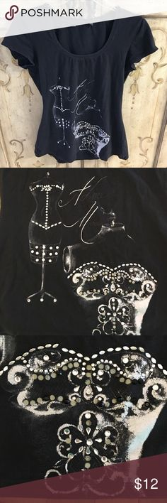Blingy Cap Sleeve Tee Worn once or twice. Black cotton scoop neck tee with cap sleeves. Has a bodice design with bling on it. A couple stones missing which I didn't notice until taking pictures. So not noticeable. See 3rd pic. Tops Tees - Short Sleeve