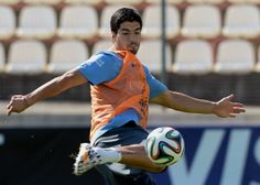 Uruguay's forward Luis Suarez kicks the ball during a training session at the Arena do Jacare in Sete Lagoas, Minas Gerais, Brazil on June 21, 2014, during the 2014 FIFA Football World Cup