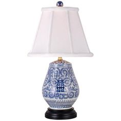 "Blue And White Vase Table Lamp -$199.91; •22 1/2"" high.   •Shade is 7"" across the top, 14"" across the bottom, 10 1/2"" on the slant.   •Base footprint is 8"" round."