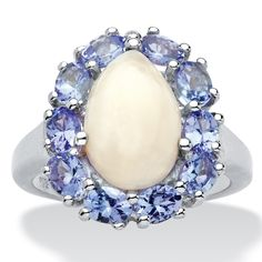 The pure beauty of opal is really brought to life by dazzling tanzanite accents, 3.05 carats T.W. Decorating your finger-iT3l1uaF