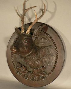 nice antique black forest carved wood deer head on a round plaque