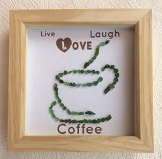 Hand made framed sea glass picture.. Live Laugh Love coffee... All the sea glass in this picture has been hand picked by myself from seaham beach then glued into place Sea glass may differ slightly with the one you receive pictures have been taken without the glass in the frame to