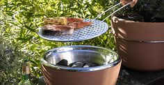 The Hot-Pot BBQ not only allows users to grow herbs, but you can also use it to cook your next meal. The terracotta pot is divided into two layers, where the top half that house...