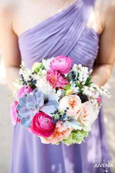 & the matching pink, green and peach bridesmaid bouquet. the dark berries make this colorful bouquet work!