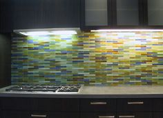 Really like this color scheme with the dark wood cabinets.                             Breadstick backsplash in kitchen in Seattle
