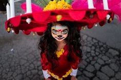 Costume... a decorative costume for Day of the Dead complete with candles on her ultra wide brimmed hat. Photo by Scott Ball.