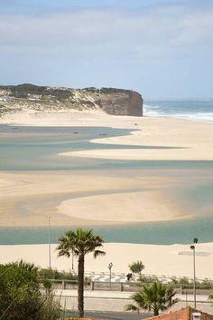Foz do Arelho, Caldas da Rainha, Portugal. The Foz do Arelho beach, next to the amazing Óbidos Lagoon, is a place where nature has offered us its wonderful therapeutic qualities and an extensive sandy area.