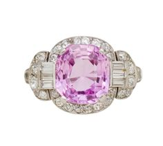 An art deco pink sapphire and diamond ring, Raymond Yard, circa 1925  centering a cushion-cut pink sapphire, surrounded by old European, old mine-cut and baguette-cut diamonds, with millegrain accents; signed Yard for Raymond Yard; pink sapphire weighing approximately: 4.90 carats; estimated total diamond weight: 1.20 carats; mounted in platinum;
