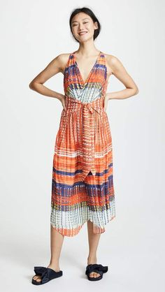 Ramy Brook Printed Ella Dress. Crisscross panels and a peek of skin at the back give this eclectic Ramy Brook dress a relaxed, wrapped effect which is accentuated by ties at the waist. #dresstoimpress #summerdress #summeroutfit