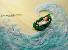 """Beautiful photo of newborn baby boy sleeping on a leaf, crashing in the waves in the midst of the storm, yet protected by a ray of light watching over him. """"Hope in the Storm"""" God's protection. Peace. Inspiration. Miracle. water breathtaking amazing unique creative floor art baby scenes painting with fabric Baby ImaginArt by Angela Forker Precious Baby Photography New Haven Fort Wayne Indiana #RayofHope"""
