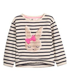 Light beige/rabbit. Sweatshirt with sequined embroidery at front and ribbing at cuffs and hem. Slightly longer at back.