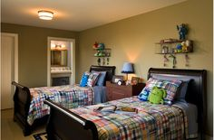 "clean looking shared boys room, with a patterned or colored bedding. above bed is a shelf in which you can display the boys interests (monster trucks, spider man) without having to invest in painting the walls or tons of ""stuff"""