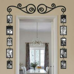 Great doorway entrance. Hanging pictures like this is great in places with little wall space.