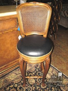 Swivel your way into conversation. Dark cushioning nicely contrasts the bright wood. Set of two nailhead bar stools in brown. Measures 30 inches in height.