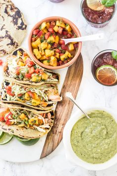 Grilled Salmon Tacos with Chipotle Mango Salsa and Tomatillo Avocado Slaw - These are completely Paleo with one ingredient paleo taco tortillas!