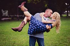 Use the rain to your advantage! Kissing in the rain. :)   Kathy Turpin Photography