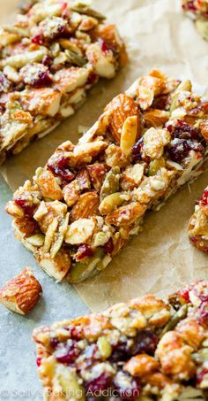 Spiced Pumpkin Seed Cranberry Snack Bars Homemade copycat KIND bars with pumpkin spice, almonds, pumpkin seeds, and dried cranberries. Grain-free and just what you need this Fall! Healthy Granola Bars, Homemade Granola Bars, Healthy Bars, Healthy Snacks, Healthy Recipes, Homemade Kind Bars, Protein Bar Recipes, Healthy Breakfasts, Protein Snacks