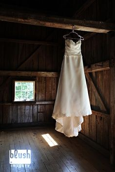 dress hanging in barn