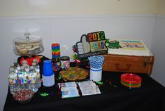 """Thanks Pinterest for all your ideas!  Here's my dessert table for Chris's Oh the Places You'll Go graduation party.  Used duct tape for water bottle lables, Hershey bars w/ his picture, cookies that look like they fell out of a Dr. Suess book, thanks to Dana for the beautiful and delicious cupcakes.  M striped in tall vase, from target """"polka dot"""" candy (malted milk ball and gumballs), paper straws, from the dollas bin at Target tin pails for plasticware. Pretty happy w/ the results."""
