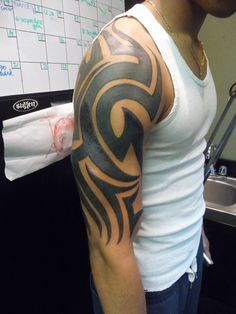 Tribal tattoo i fixed up. Covered all the squiggly lines Tribal Tattoo Cover Up, Tribal Chest Tattoos, Tribal Shoulder Tattoos, Small Shoulder Tattoos, Tribal Tattoos For Men, Tribal Tattoo Designs, Cover Up Tattoos, Tattoo Sleeve Designs, Small Tattoos For Guys Arm