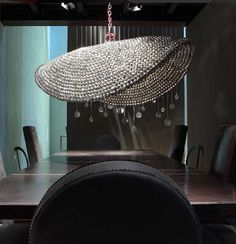 This glitzy-lamp chandelier would look gorgeous over the perfect table.