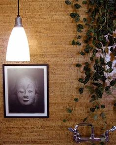use cork flooring on walls to create a sound dampening effect