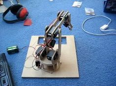 Robot Arm You Can Build At Home  http://jjshortcut.wordpress.com/2010/04/19/my-mini-servo-grippers-and-completed-robotic-arm/