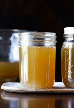 Homemade Chicken Stock is incredibly easy to make! The flavor my homemade stock recipe adds to chicken soup, pasta dishes, rice, and more is incredible. AND it's delicious all on its own with tons of health benefits that come from bone broth. You'll want to make a big batch of this and keep it in your freezer to enhance any meal! #cookiesandcups #homemadechickenstock #bonebroth #chickenstock #chickenbroth #chickensoup
