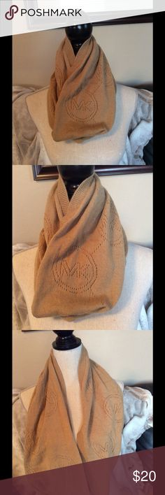 Michael Kors Infinity scarf Tan infinity scarf by Michael Kors with knitted MK Logo. Michael Kors Accessories Scarves & Wraps