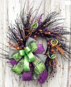 "Fun Halloween Glitter Wreath is just ready to welcome the Trick -or- Tr-eaters! This Fun Halloween wreath is surrounded with great grass and berries, Just Fun for the season.. Dimensions 20""x20"" and 6"