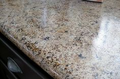 Fake granite counter tops created with primer and paint.  Looks real!~ I've been wanting to do this for a while..Maybe this winter.