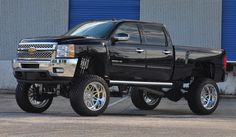 "2011 CHEVY SILVERADO 2500 HD 24""x14"" Evo SS8 Wheels from American Force Wheels and 38x13.5x24 Trail Grappler tires."