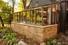This energy efficient greenhouse has a brick base for thermal mass. Attachment to the house also helps with efficiency. Greenhouse Attached To House, Diy Greenhouse Plans, Heating A Greenhouse, Lean To Greenhouse, Backyard Greenhouse, Miniature Greenhouse, Landscape Arquitecture, House Goals, Gardens