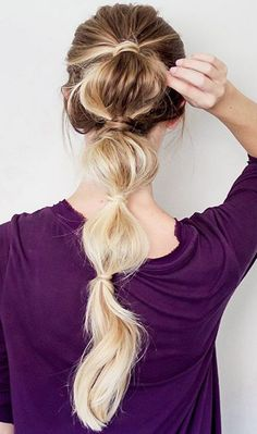 Bubble Braid Ponytail with Ash Blonde Luxy Hair extensions which Erin Howards custom coloured at the top to match her roots. Check out our Luxy Hair blog to see how she did it!