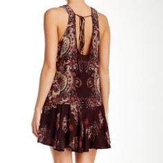 FREE PEOPLE Printed Back Shift Mini Dress Sold out in stores! Free People printed mini slip dress with beautiful cut out detail in back. Dropped waist with flounce hem gives a flattering feminine look. Burgundy with rose print. Rayon. Imported. Only worn once. Free People Dresses Mini