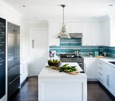 The perfect kitchen!  Great lines, crisp and clean, chalkboard, beautiful appliances and to die for tiles!  House of Turquoise: Jute Interior Design
