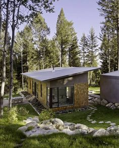 Fish Creek Guest House, a small modern home by Carney Logan Burke. Of course it's the trees around this tiny home that make it complete.