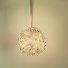 Handmade christmas bauble made from buttons, pins and a polystyrene ball.